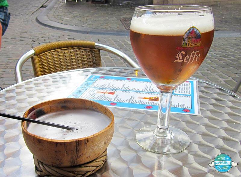 Sampling locally-made coconut beer, served in a coconut-shaped bowl