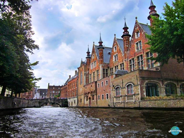 Take a canal cruise during a long weekend in Bruges